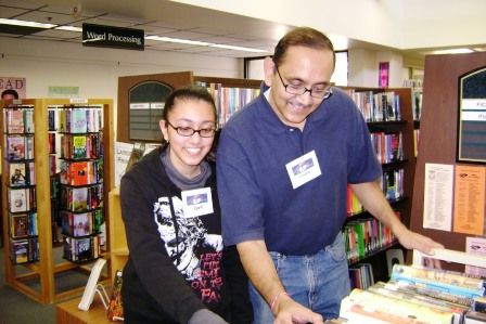 Father and Teen Daughter using the library