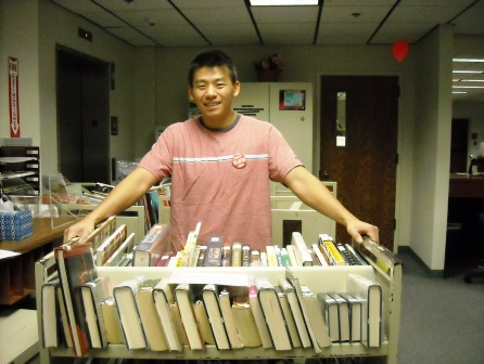 Volunteer with book truck at Central Branch