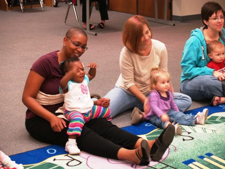 Moms and babies in storytime.